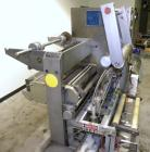 Used- Holmatic CBS-18-4F Tamper Evident Inline Heat Sealer. Capable of speeds up to 160 cpm. Three seal head system last run...