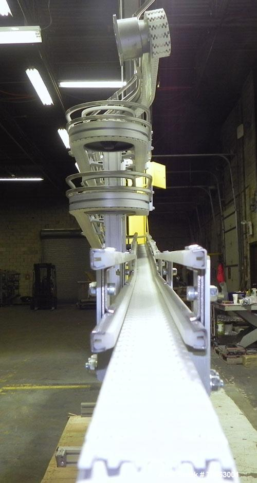 "Used- Flexlink Alpine XL 63 mm Buffer Vertical J Shape Chain Conveyor. Top section 100"" into 9"" 180 degree turn into four 72..."