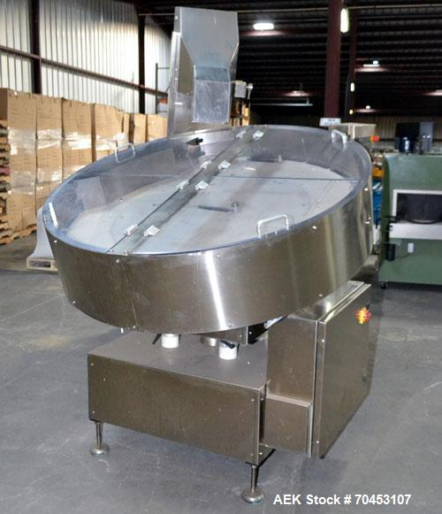 Used- Ozaf AC/1500 Bottle Unscrambler, capacity approximately 170-180 units per minute. Includes an OZAF integrated elevator...