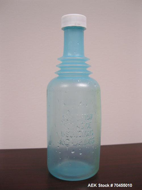 Used- Omega Design Corp Model 4D-RP2-12 Bulk Bottle Unscrambler. Capable of speeds over 200 bottles per minute. Set up with ...