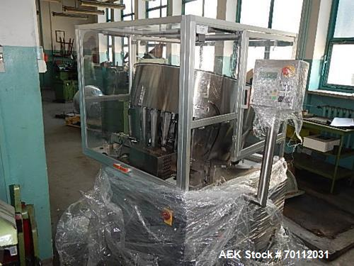 Used- Ozaf Automatic Bottle Unscrambler, Model RO/1000. Speeds up to 110 bottles per minute. Ozaf E40V bottle hopper and ele...
