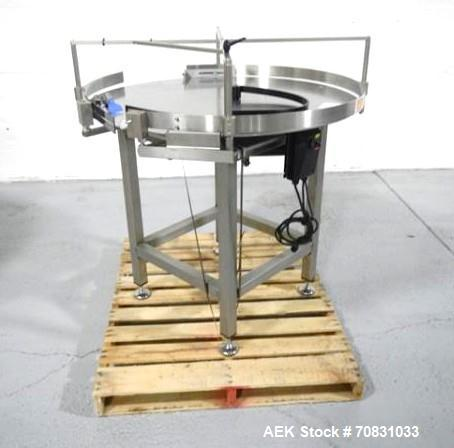 "Used- Accumulation Table, 42"" Diameter, Stainless Steel. On stand with motor drive."