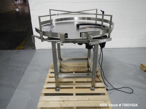 """Used- Accumulation Table, 42"""" Diameter, Stainless Steel. On stand with motor drive."""