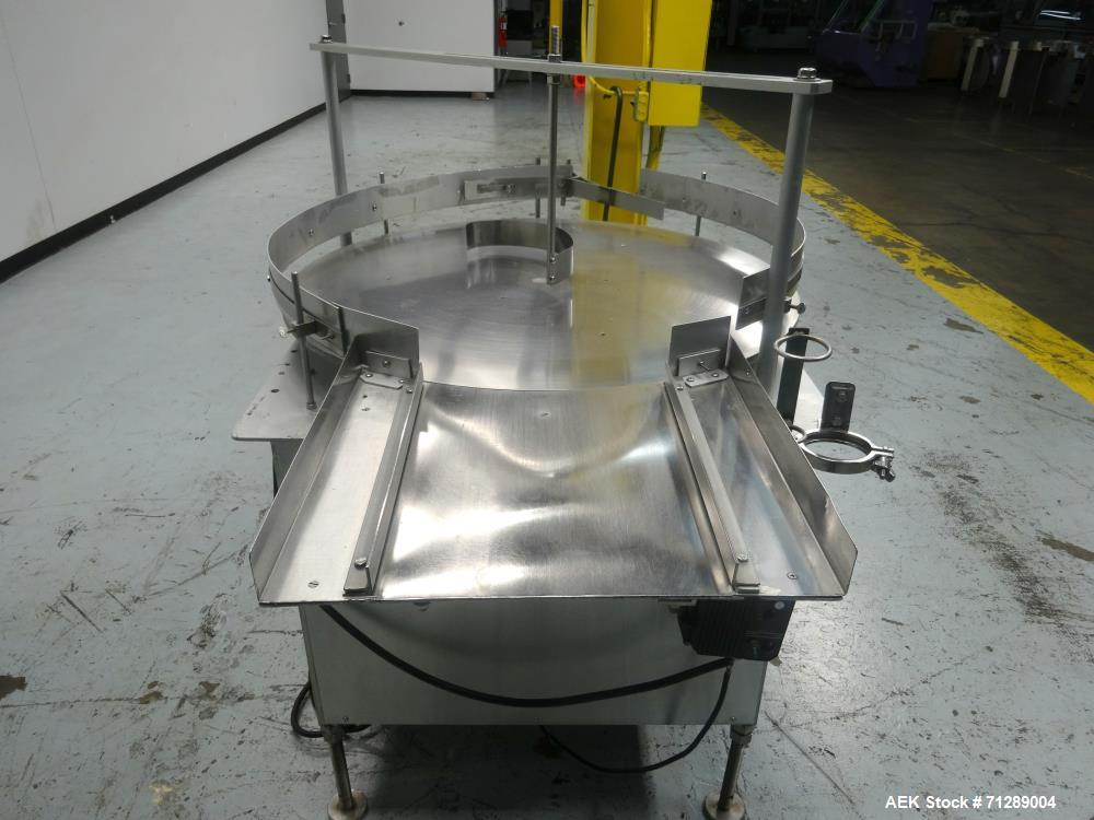 "Used- Kalish Rotary Accumulation Table. 36"" Diameter. Adjustable speed control. Stainless steel construction. Mounted on (4)..."