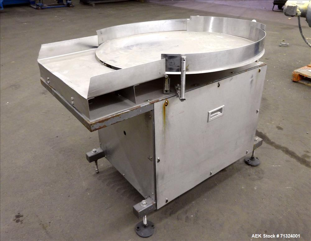"Used- Accumulation Table, 36"" Diameter. Stainless steel construction. Driven by an approximate 1/4 hp motor. Mounted on (4) ..."