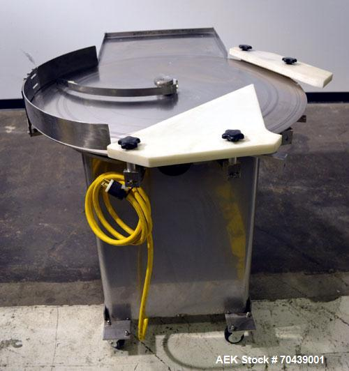 Used- Cozzoli Unscrambler/Accumulating Table, Model UT36, Stainless Steel. 36'' Diameter table with rectangular dump section...