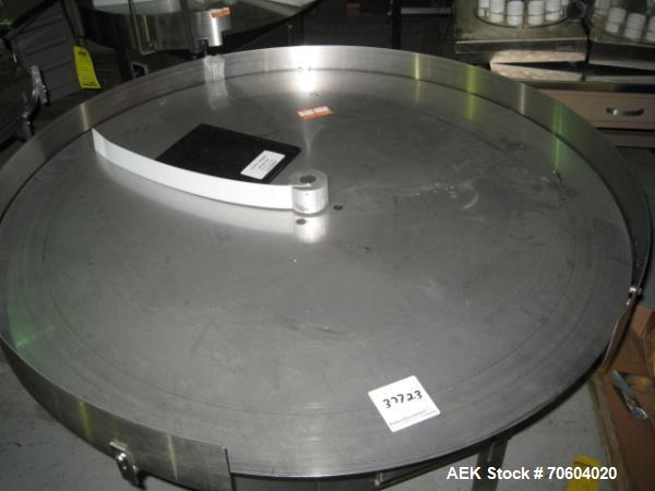 """Used- Garvey 48"""" accumulation table, model 1560, stainless steel construction, 110 volt, serial# 17136."""