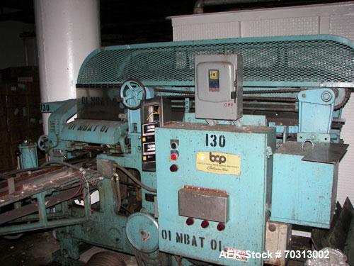 Used- Battle Creek Model Overwrapper Horizontal Flow Wrapper. Last used on cartons of candy. Has overhead lug chain pull thr...