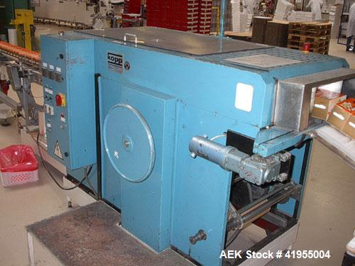 Used-Kopp Maden ME 4-12 B100 Wrapping/Bundling Machine for single overwrapping or bundling. Output 60-80 single wraps per mi...