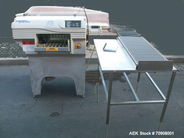 Used-Mettler-Toledo Exact Wrapper, Model 645 XL-11.  90 Degree gravity conveyor, 3' accumulator table.