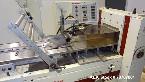 Used- Ameripak Model 140S Horizontal Wrapper capable of speeds up to 100 feet per minute. Printed Film Registered Wrapper is...