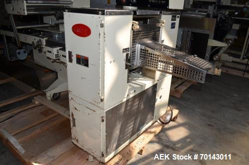 Used- Doboy Horizontal Flow Through Wrapper with Film Registration, Model J 400 PPM. Electrical 3/240/60, Mfg. 1992.