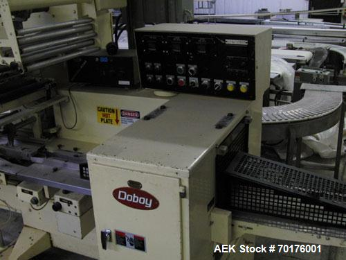 Used-Doboy Model J Horizontal Wrapper capable of speeds over 200 packages per minute. Film registration, 1 up sealing head 1...