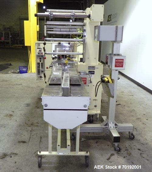 Used- Doboy Mustang IV Horizontal Wrapper. Machine is capable of speeds up to 90 cpm. The Doboy is a 1 up unit with film reg...