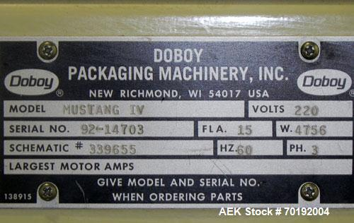 Used- Doboy Mustang IV Horizontal Wrapper. Machine is capable of speeds up to 150 cpm. 1 up unit with film registration andA...