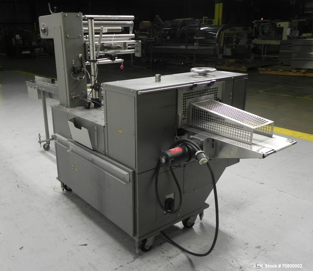 Used- Doboy Mustang IV Horizontal Wrapper. Machine is capable of speeds up to 150 cpm. 2 up unit with film registration. Pac...
