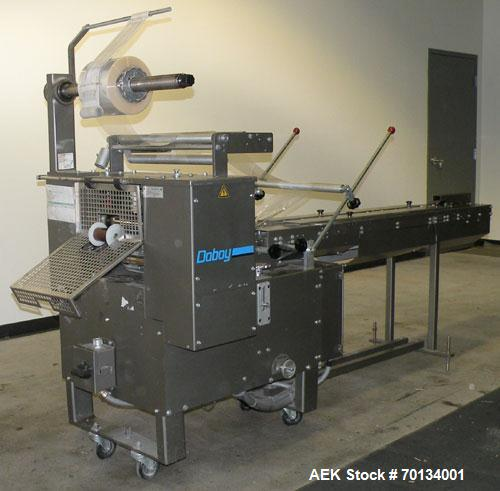 Used- Doboy Scotty II Horizontal Flow Wrapper. Capable of speeds up to 75 packages per minute. Has 5' Long lugged chain infe...