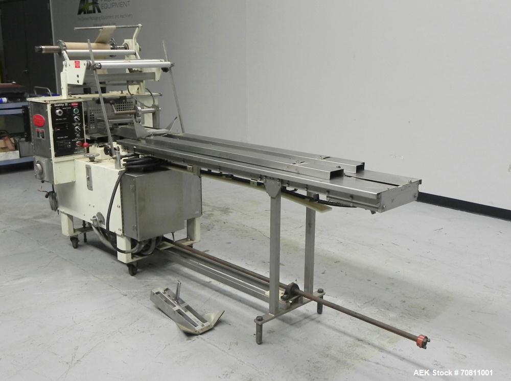 Used- Doboy Model Scotty II Horizontal Flow Wrapper. Machine is capable of speeds up to 60 packages per minute. Has 6' Long ...