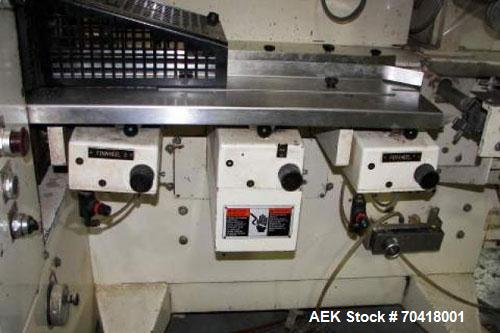 Used-Doboy Model J Wrapper with incline product feeder. Servo driven smart belt positions products to the infeed lugs of the...