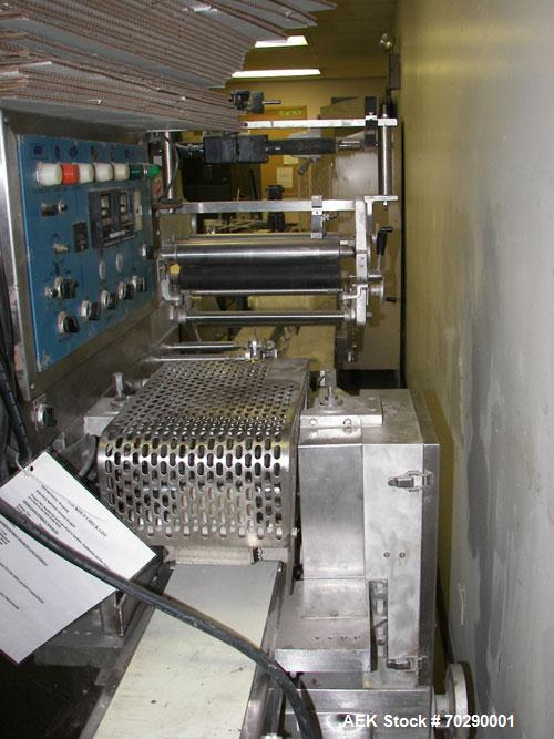 Used- Fuji Formost FW370 Horizontal Wrapper. Machine is a 1 up unit and is capable of speeds up to 120 caps per minute (240 ...