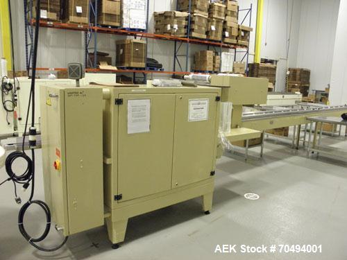 "Used-Ilapak Cougar Wrapper, Model ""UNO"", capable of speeds up to 120 packages per minute. Has extended lugged chain infeed. ..."