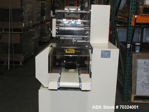 Used-Hopak Model HP-305I Horizontal Flow Wrapper. Has print registration.