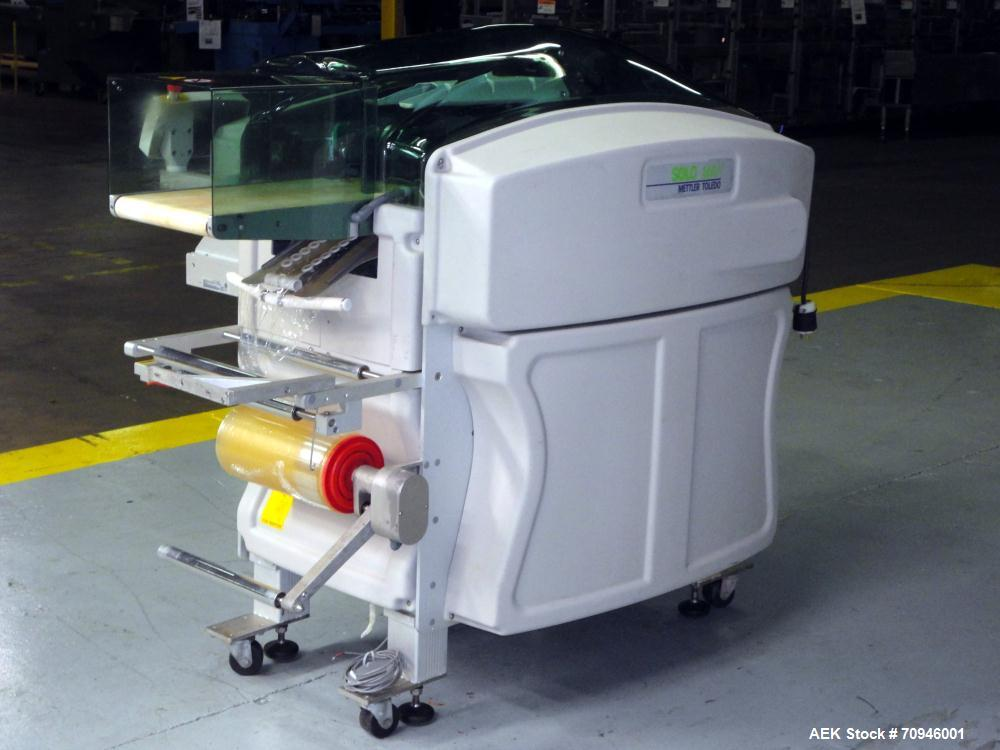 """Used- Exact Equipment Solo Max Automatic Stretch Wrapping Machine. Capable of speeds up to 30 ppm. Tray size from 7.1""""L to 1..."""
