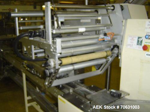 """Used-Otem M300DX Flowpack Wrapper. Maximum pack height 3.5"""" (90 mm). Maximum pack length 15"""" (380 mm). Knives 9.4"""" (240 mm) ..."""