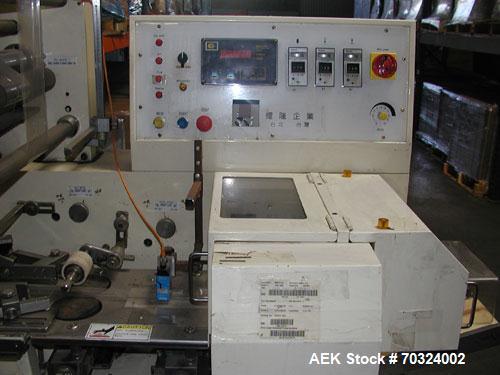 Used- Sinlon Model SL-920HE Horizontal Flow Wrapper. Has print registration.