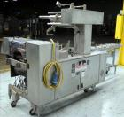 Used- Bosch (Doboy) Linium 311 horizontal wrapper. Parts Machine Only.  1 up crimper capable of speeds up to 150 packages pe...