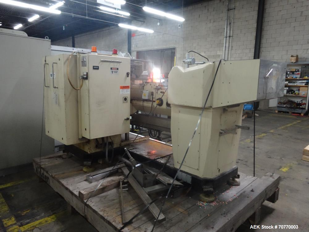 Used- Autowrappers Automatic Intermittent Motion Roll Wrapping Machine, Model S-