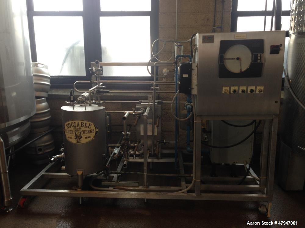 Used- APV Apple Cider Pasteurizer. Plate and frame heat exchanger, on skid. Model PPAC-05, Apple cider flowrate at 40 degree...