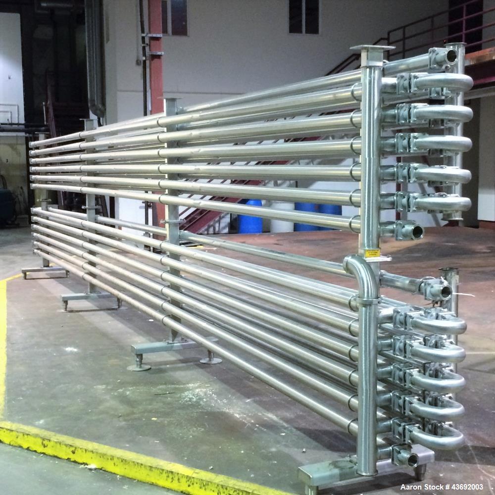 Used- Feldmeier Shell and Tube Heat Exchanger/Pasteurizer Rack, Model DT252. 720 feet of tubing. 304/316 stainless steel pro...