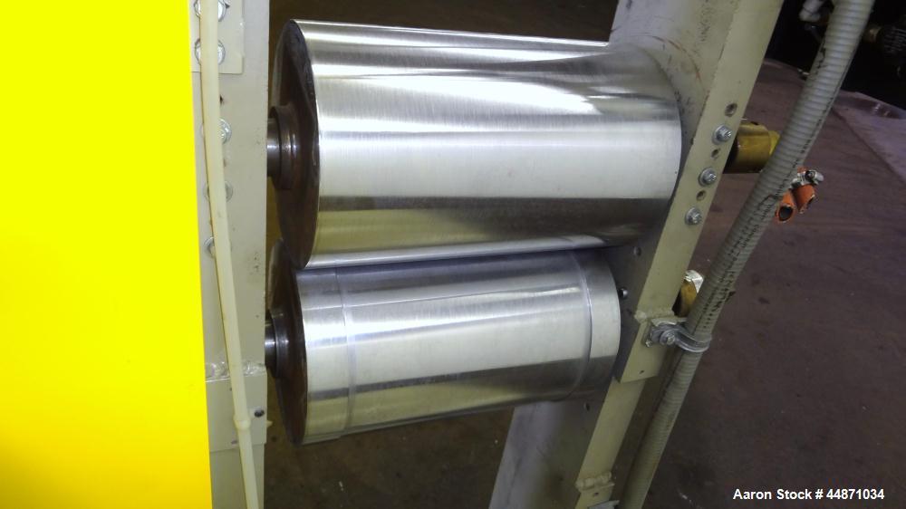 "Used- Michigan Plastics Machinery Embossing Stand.  (2) Approximately 8"" diameter x 12"" long cored rolls, pneumatically adju..."