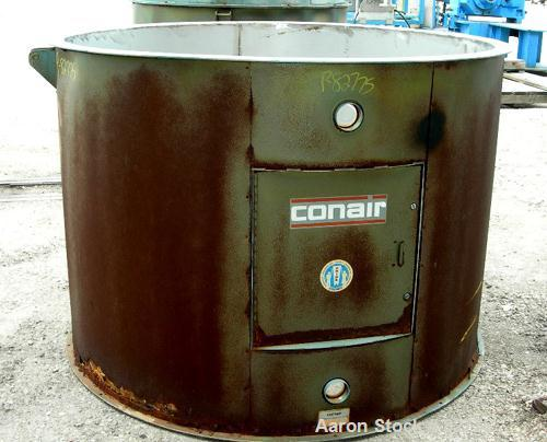 USED: Conair insulated dry hopper, model 18053804, approximate 215 cubic foot capacity, stainless steel. Carbon steel sheath...