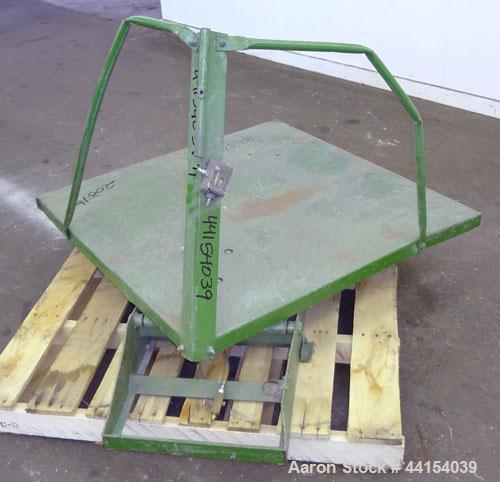 """Used- Gaylord Tilter, Carbon Steel. Approximate 44"""" long x 44"""" wide platform, air operated tilt. Mounted on a frame."""