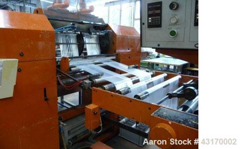 Used-Coemter Ter-Roll 7070/4 Bag Making Machine.  Maximum capacity 330 feet/min (100 meter/min), 15 roll shifts per minute, ...