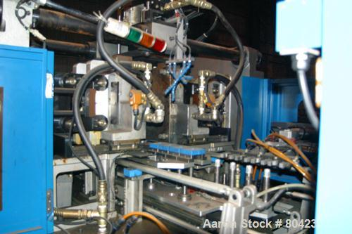 USED: Frontier orientation stretch blow molding machine. 4 blow station machine with 3 conditioning stations (heating). Prog...
