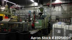 Used- Millcreek Blow Molding Machine. Rotary. 4 Station. Setup to run 1 gallon HDPE bottles with level strip. Does not inclu...