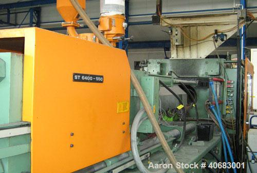 Used-Stork ST4000-550 blow molder. Year of construction 1986. Clamp pressure 550 t, CDS 385 control panel, Geiger LR 21 CNC ...