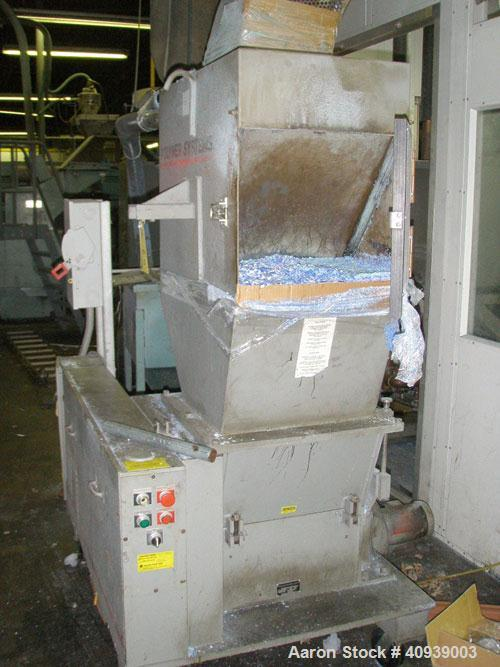 Used- Uniloy Model 350R2 6-Head Blow Molder, serial #4665, new December 1998. Has Maaco 8000 programmer, pedestal operator c...