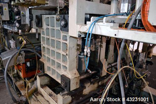 Used- Uniloy Milacron Alkam Stretch Blow Molding Machine, Model BM-4. (4) Blow cavities/mould, 130mm distance between caviti...