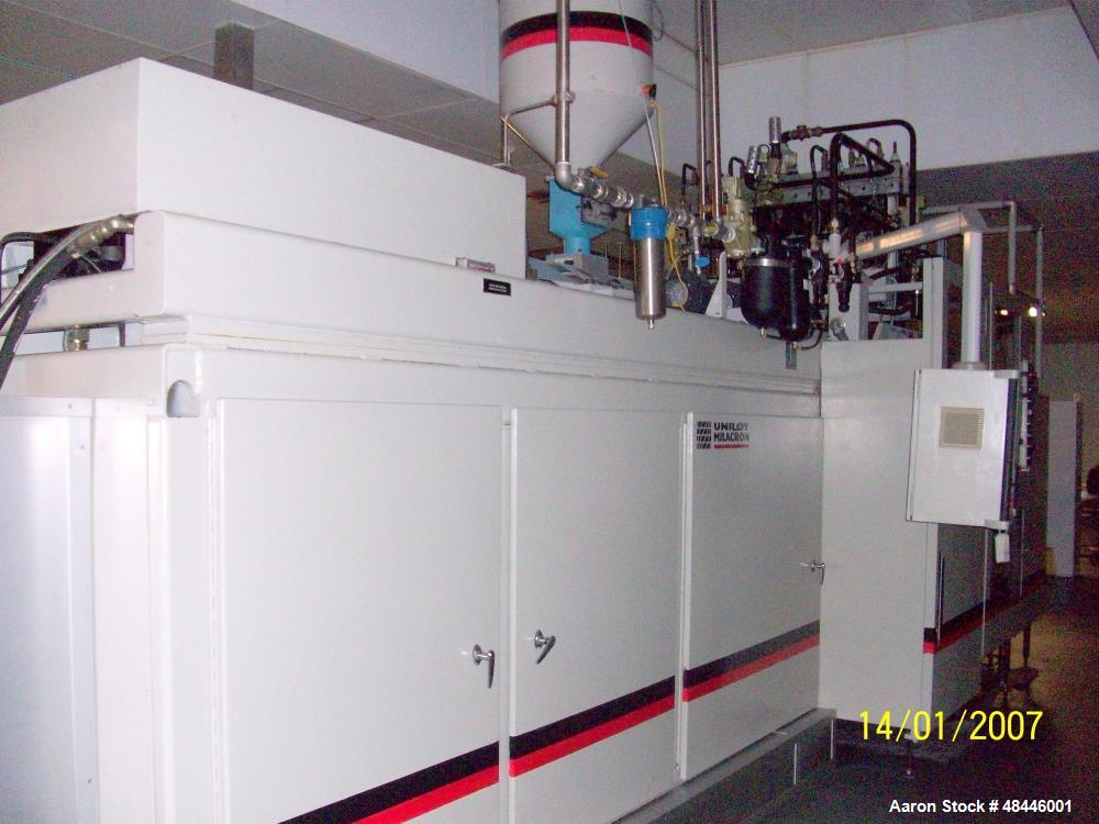 Used- Uniloy Reciprocating Screw Intermittent Extrusion Blow Molding Machine, Model R2000.  80mm diameter reciprocating scre...