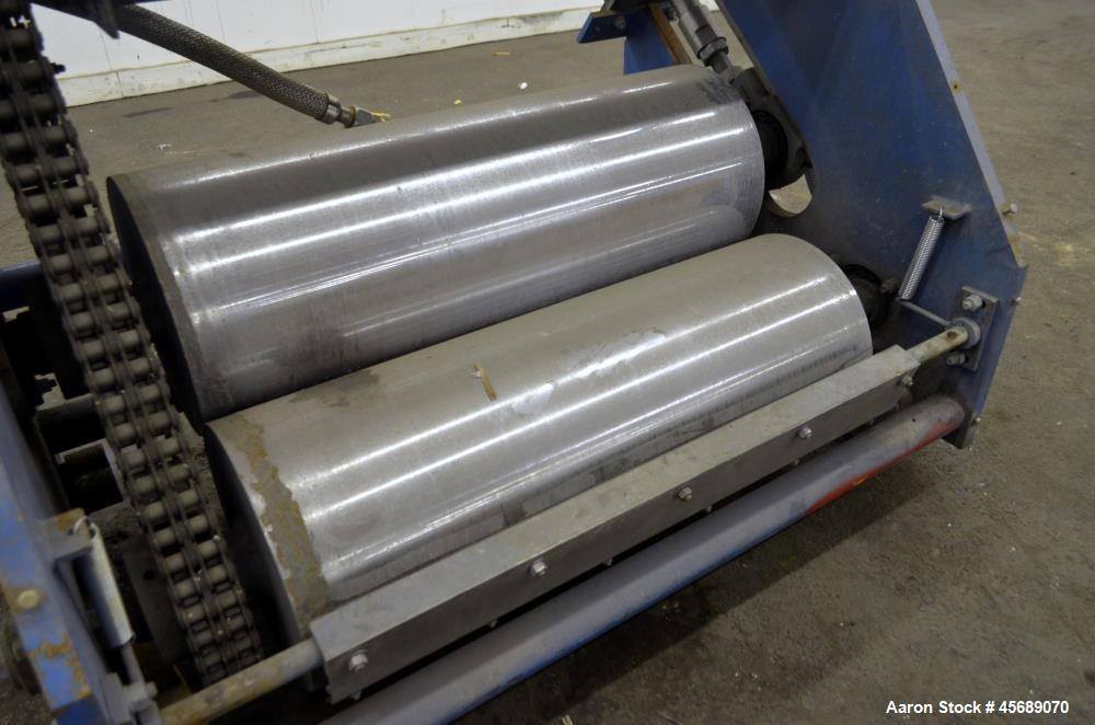 """Used- APV Chill Roll Stand. (2) Approximate 12"""" diameter x 32"""" wide chrome plated cored rolls. (1) Fixed, (1) manually adjus..."""