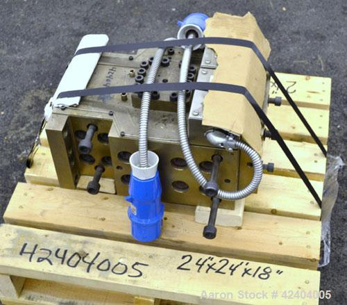 """Used- Die Block. Approximate 2""""wide x 3/4""""tall, 3/4"""" diameter back center feed."""