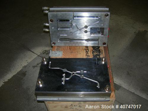 Used- ASTM Test Mold. Last used with an 85 ton injection mold machine.