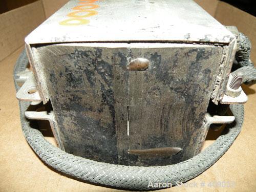 Used- Brabender 3/4'' wide strip die. Back center feed. 240 volt, 850 watt.
