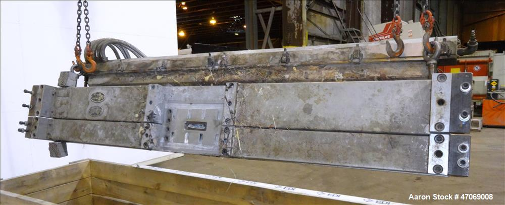 "Used- EDI Extrusion Dies 73"" Wide Autoflex H40 Sheet Die. Approximately 4"" wide x 3/4"" tall back center feed. Lip opening 0...."