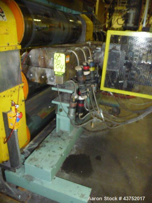 "Used- EDI 54"" Wide Ultraflex H75 Flex Lip Sheet Die. Back center feed, mounted on stand."