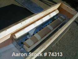 "USED: EDI Masterflex sheet die, 38"" wide, model R/LD-75. Coat hangardesign, 2"" back center feed."